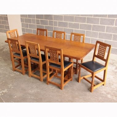 Robert Thompson 'Mouseman' Oak 7'Dining Table and 8 Chairs