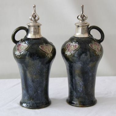 Pair of Doulton Lambeth Silver Mounted Flasks.